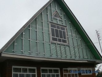 Roof gable, wooden gable, decoration of the gable and mansard roof of a private house