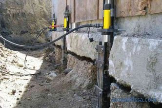 Strengthening the foundation of a brick private house, how to strengthen and strengthen the old foundation, photo