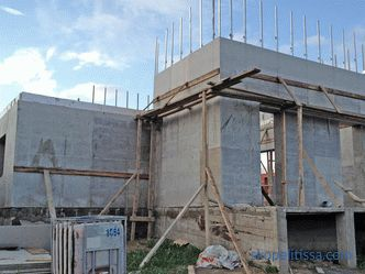 Construction of country houses from reinforced concrete panels - what kind of technology