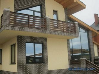 Exterior finish of the house from a bar, design of a facade outside, materials, technology, photo