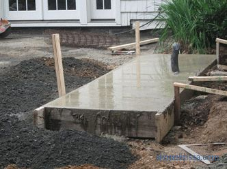 Brick grill, foundation for a barbecue oven and a brick grill, stages of construction, photo